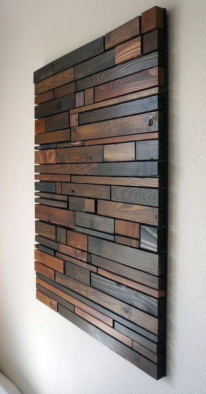 This piece is made to order. Lead time for shipping is 1 week . The photo shown is a previously sold beautiful modern art piece made with reclaimed wood. We have finished each piece of wood by hand then used 4 different shades of stain. These natural colors keep the rustic look of the wood by bringing out the grain while also giving it a modern touch by the way the pieces are placed together. This would look great hanging vertically in a bedroom, above a couch in a living room or anywhere…