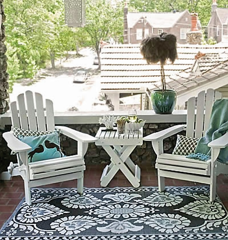 Adirondack Chairs are a classic choice for an apartment balcony.  Comfortable too!