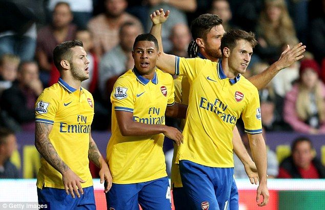 What a moment: Serge Gnabry (second left) is mobbed by his teammates after scoring his first Arsenal goal in the 2-1 win at Swansea City