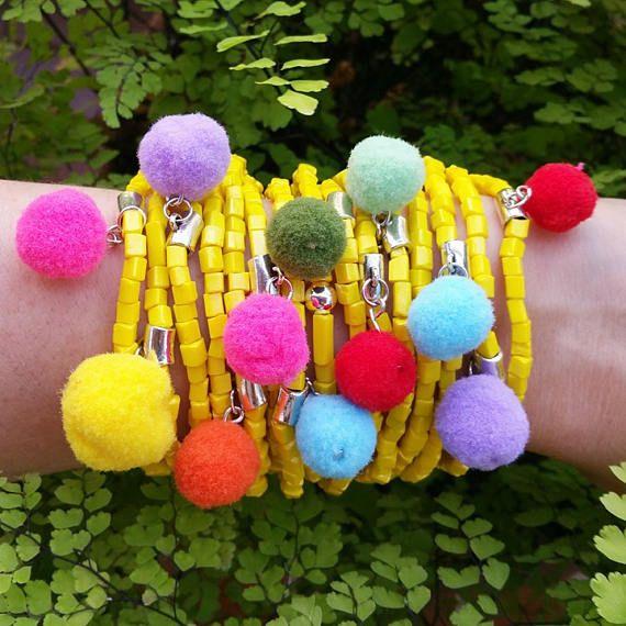 Check out this item in my Etsy shop https://www.etsy.com/listing/535277509/pompom-bracelet-boho-bracelet-stackable