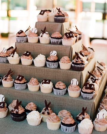 this chocolate cupcake-tower is a version of a groom's cake that highlighted the groom's favorite hobbies: skiing, playing softball, and reading books