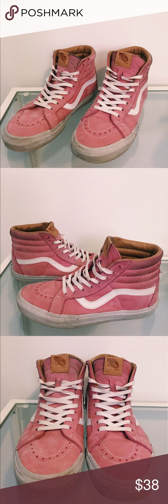 Pink Suede Sk8-Hi Vans Pink suede Vans Sk8-His with white bottoms and tan leather lining along interior near ankles. Lightly worn with discoloration (darkening) along the tops of both shoes. Make me an offer! Vans Shoes Sneakers