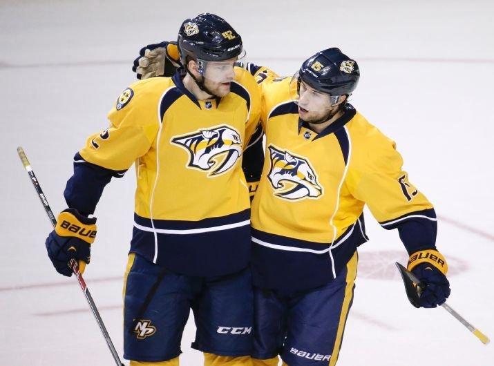 Nashville Predators forward Craig Smith (15) is congratulated by Mattias Ekholm (42), of Sweden, after Smith scored against the Chicago Blac...