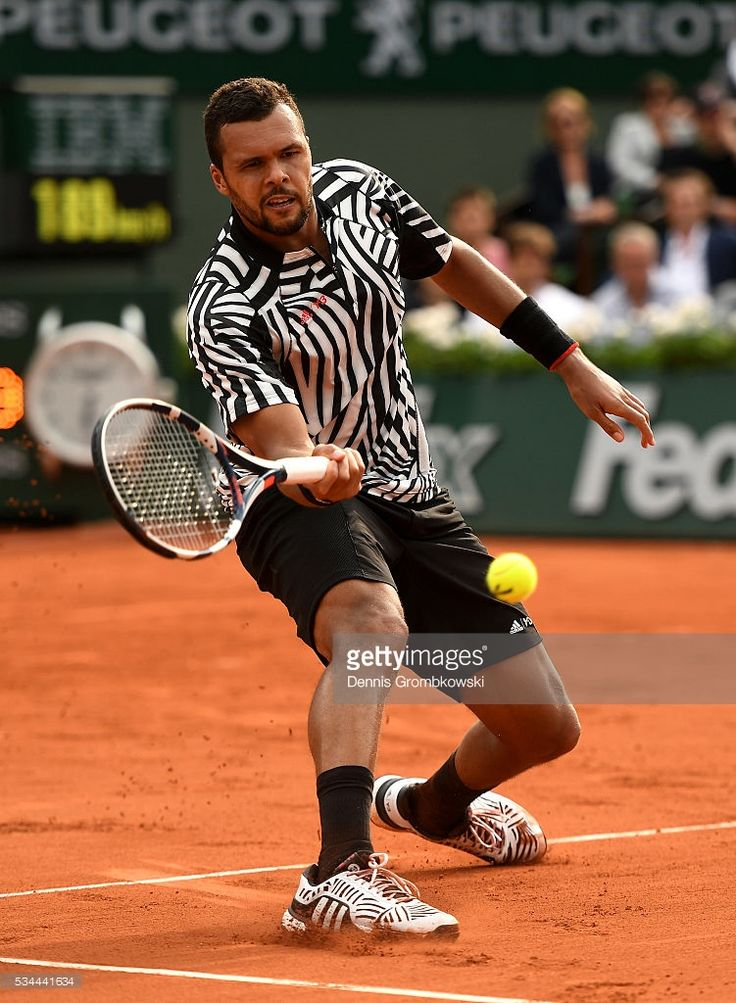 Jo-Wilfried Tsonga of France hits a forehand during the Men's Singles second round match against Marcos Baghdatis of Cyprus on day five of the 2016 French Open at Roland Garros on May 26, 2016 in Paris, France.