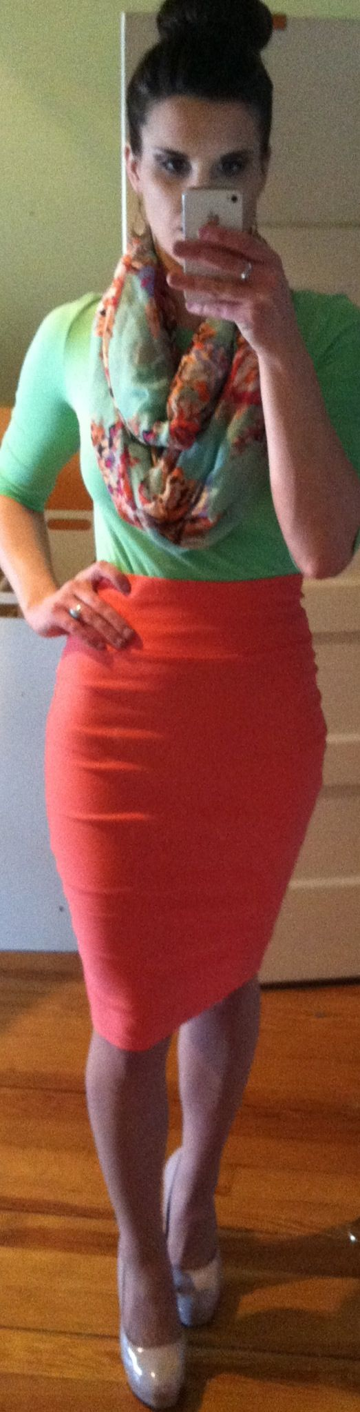 Coral pencil skirt, bright green top, mint floral scarf, and nude pumps.