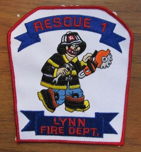 "Lynn Fire Dept. Rescue 1 ""Simpson cartoon with a chain saw"""