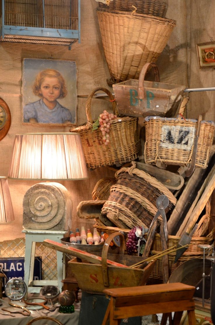 In one corner they dig through a stash of old trunks and baskets that are piled to the ceiling.