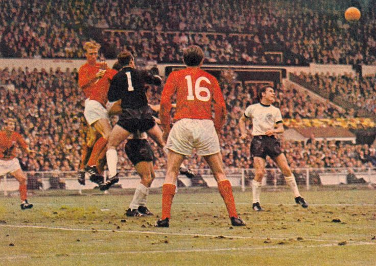 30th July 1966. England duo Jack Charlton and Geoff Hurst unsettling West German goalkeeper Hans Tilkowski, in the World Cup Final.