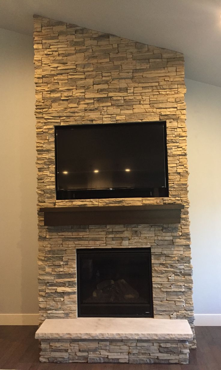 Floor to ceiling Alderwood stacked stone fireplace face ...