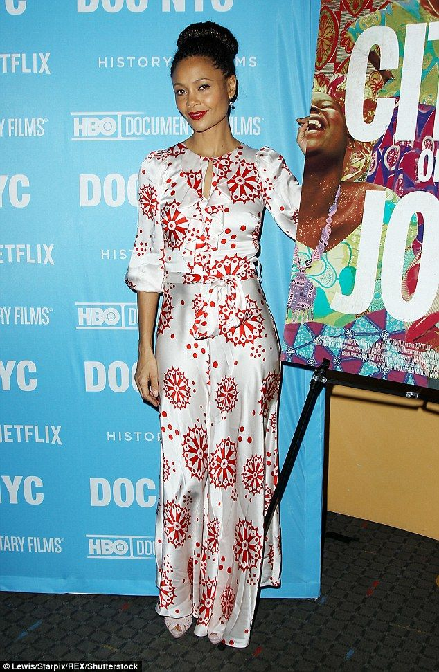 Dazzling: The Westworld star looked gorgeous in a white silk dress with red print...