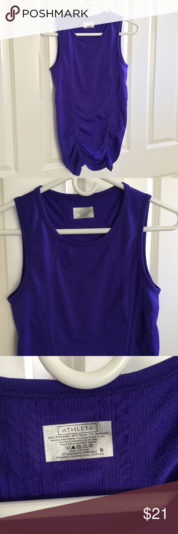 Athleta Athletic Top Tank Sleeveless Purple Small Athleta women's athletic top / tank.  Sleeveless.  Ruched in front and back.  Solid deep purple.  Size Small.  About 15 inches from armpit to armpit.  About 27 inches from shoulder to hem.  Very gently preowned.  Looks and feels new. Athleta Tops Tank Tops