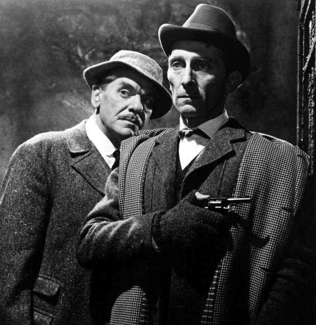 peter cushing as sherlock holmes and andre morell as dr. watson in hound of the baskervilles - 1959