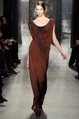 Donna Karan presents a chocolate brown flowing gown and Greco-Roman-inspired brown folds as a wrap
