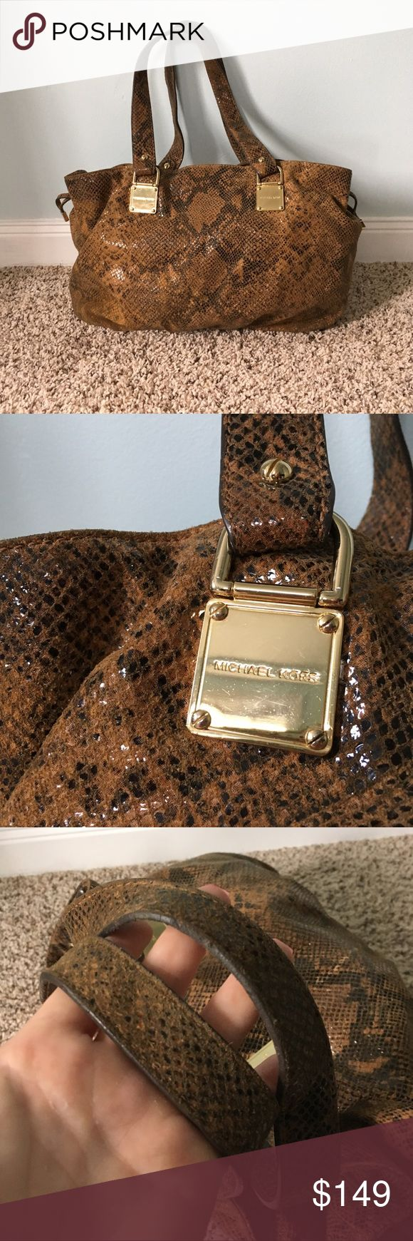 STUNNING MK Snakeskin MICHAEL KORS HANDBAG Absolutely beautiful snakeskin Michael Kors bag - brown and tan in color in good used condition with soft snakeskin exterior and clean fabric interior large sized and authentic of course Offers welcome. Ships next day. Suggested user. Posh mentor. Top rated seller. Michael Kors Bags Shoulder Bags