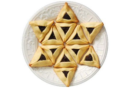 Hamantashen (also hamentaschen) are triangular filled cookies made for Purim. Traditionally the filling was made of poppyseed paste but other nut pastes (like sesame or almond) or dried fruit (like  apricots, dates, figs or prunes) are often used instead. More creative cooks sometimes use other fruit preserves, lemon curd, caramel or chocolate filling. #purim #queen_esther #jewish_celebration