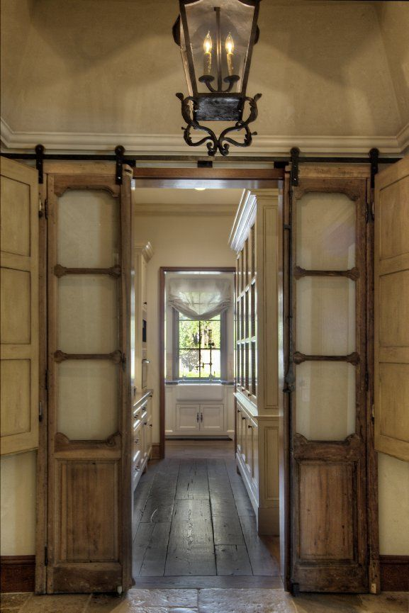 Salvaged Sidelights - shutters hinged to sidelights provide privacy - via TC Interiors - Entry/Hallway