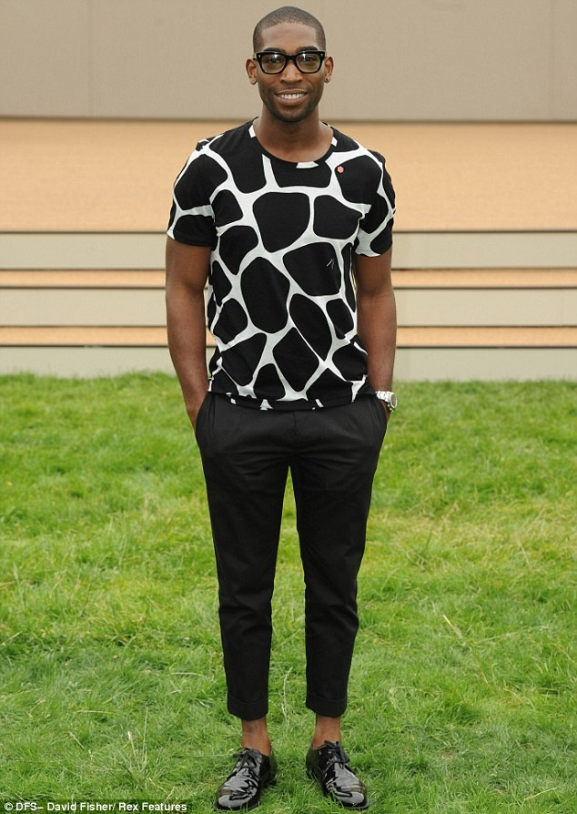 Rapper Tinie Tempah teamed a giraffe-print T-shirt with cigarette pants and brogues at Burberry