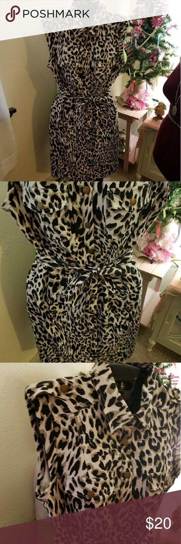 Calvin Klein cheetah print Safari dress Tire around waist for cinching cap sleeves button details about the dress Calvin Klein Dresses Midi