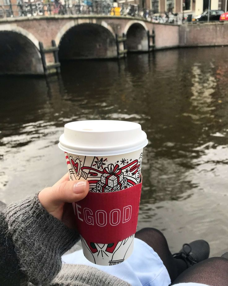 When in Amsterdam, enjoy a cup of coffee by the canal!