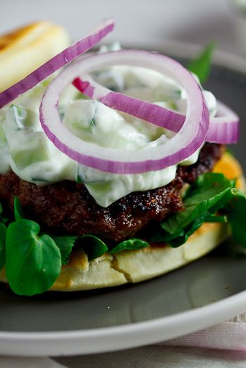 Curried Lamb burgers on naan bread with cucumber raita - making this with chicken and some other subs... But Yumm!!!