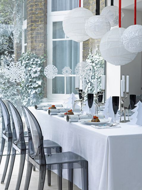 A pretty spin on the white tablecloth.  Rented ghost chairs add a beautiful contrast along with the dark wine glasses.