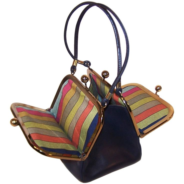 1960's Bonnie Cashin Double Kiss Lock Mini Leather Handbag With Stripe Interior | From a collection of rare vintage top handle bags at https://www.1stdibs.com/fashion/handbags-purses-bags/top-handle-bags/