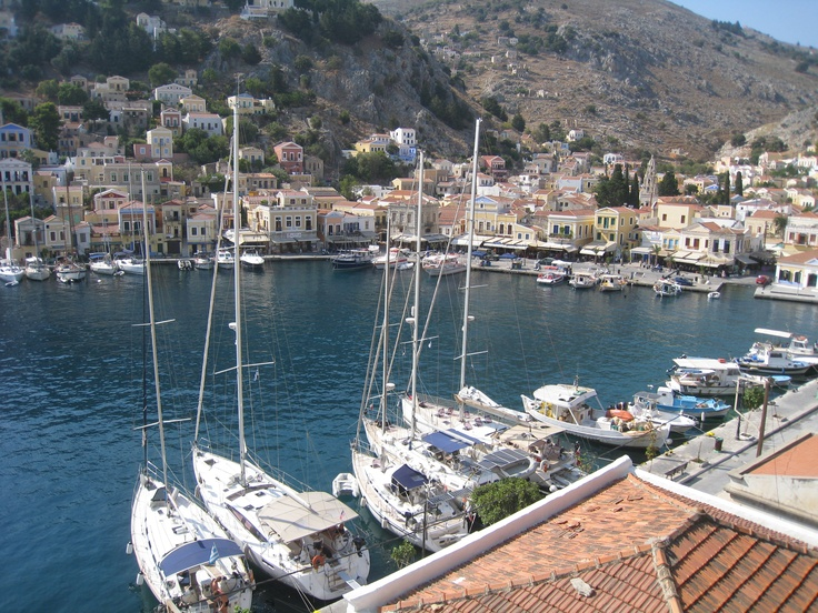 The town quay in beautiful Symi harbour. Greece