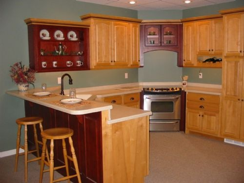 Honey maple and burgundy oak cabinets with a 2 level for Burgundy kitchen cabinets pictures