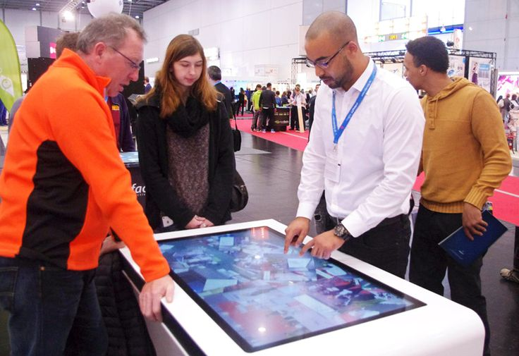 eyefactive presents awarded interactive solutions at viscom 2015: interactive touchscreen table with 3m touch display.
