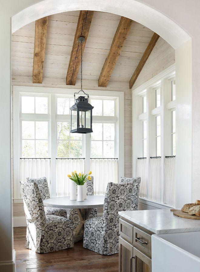 Love the lofted ceiling, exposed beams, natural light, classic furniture in a slightly rustic space