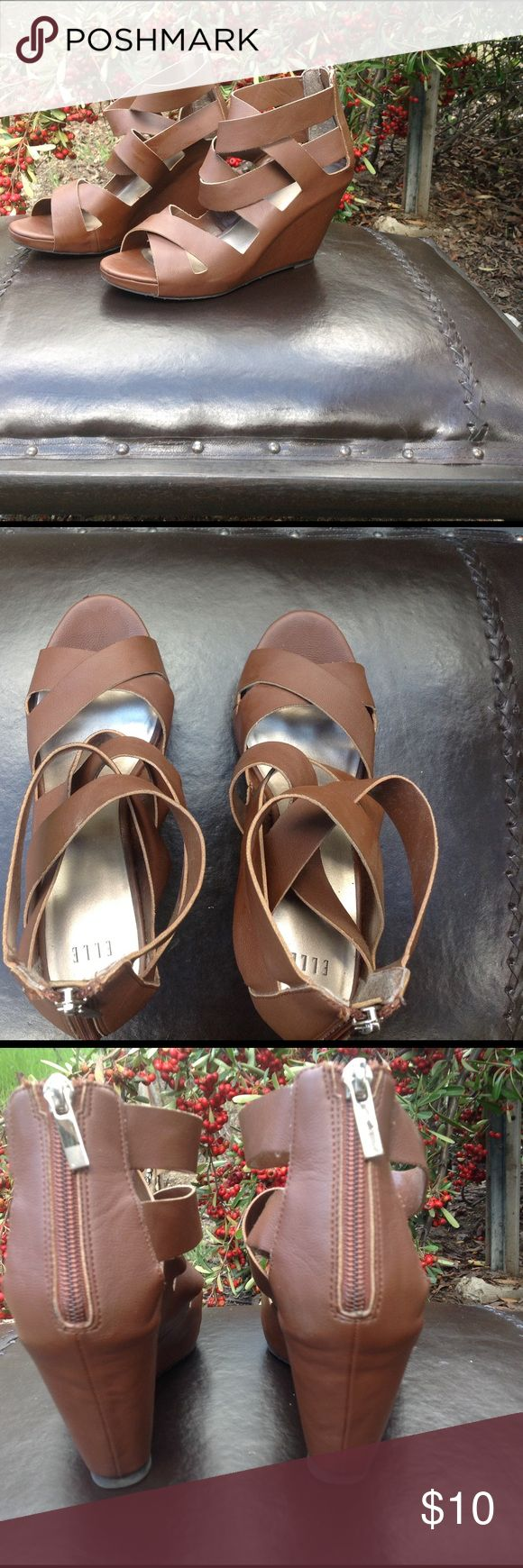 """$10 Step Into Spring 👡Sale - Elle! Great brown stappy covered heel wedge. Great with jeans, skirts, dresses and shorts. One pair of shoes for multiple great looks. EUC. Zips up the back. Man made material. 4"""" heel height from the bottom of zipper to end of heel. ELLE Shoes Wedges"""