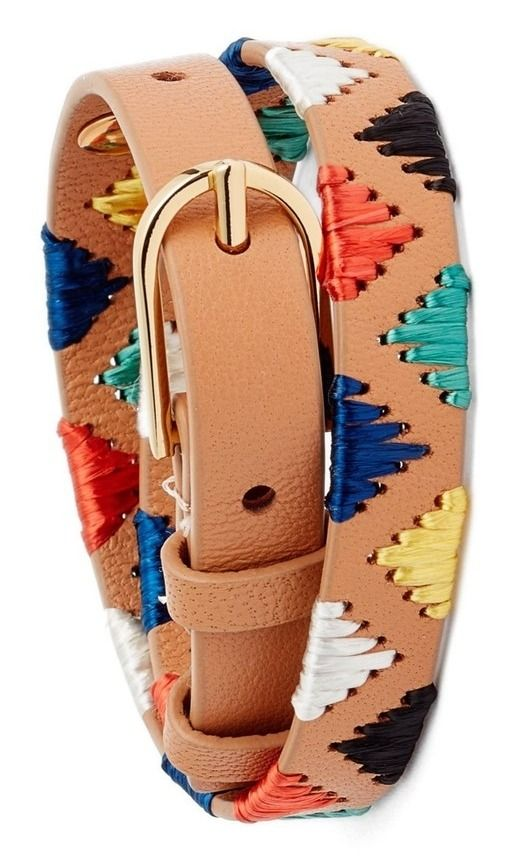 A vibrant palette of raffia embroidery puts an artful twist on this rustic leather bracelet finished with a glistening golden buckle.