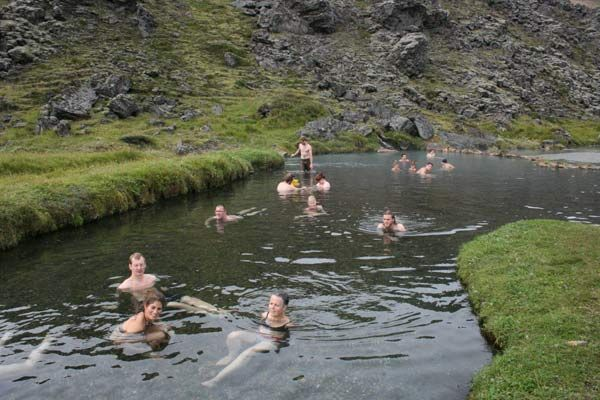 The hot springs in Landmannalaugar have a combination of hot and cold waters due to the boiling hot flows from the volcanic activity and the freezing water of the surrounding glaciers.