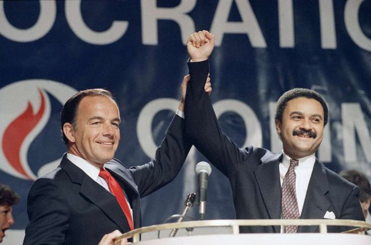 February 10,    1989: Brown elected chairman of the Democratic Party  -   Outgoing Democratic National Committee Chairman Paul Kirk Jr. ﴾left﴿, holds up the hand of Ron Brown, the new chairman, after his appointment to the post in Washington. Brown was the first African‐American to hold the top position in a major political party in the United States.