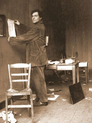 Amedeo Modigliani in his atelier, Paris ca 1915 -by Paul Guillaume [+] [Another photo taken probably the same day by the art dealer Paul Guillaume can be seen here] from Comune di Catania