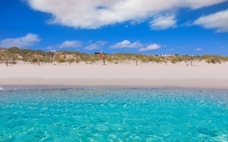Son Bou - The longest beach that's a favourite spot for swimming and sunbathing thanks to calm water and soft, fine sand. It's located on the south coast of Menorca. Overlooking this gorgeous stretch of beach are Son Bou and San Jaime villas.