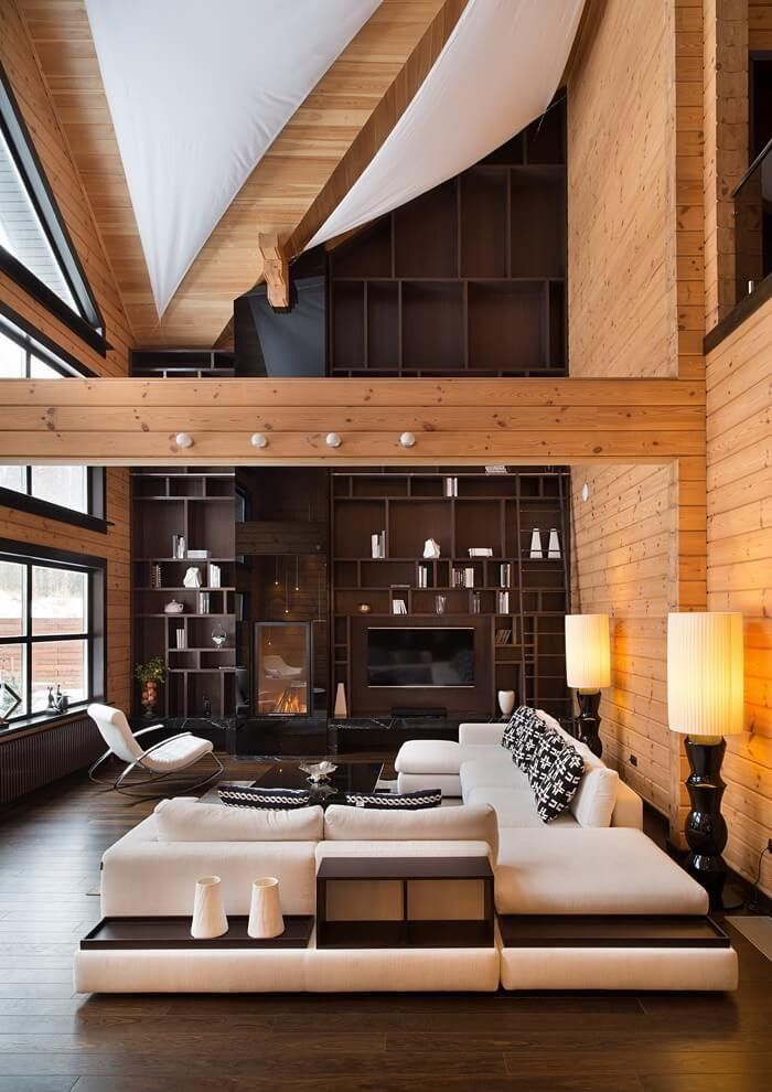 Love the tall bookcases but don't know if I'd be able to reach that high even with a ladder. Dislike the beam through the center too