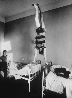Evgeny Stetsko - 1988.  Photo The spectacular recovery of the Soviet Union's gymnastics World Champion, Dimitry Belozerchev, after a serious car accident. While his leg was still in a plaster cast, he started training again and two years later regained his title.
