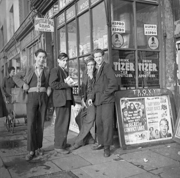 Four young men take a break outside a Stepney shop in the East End of London in 1951.