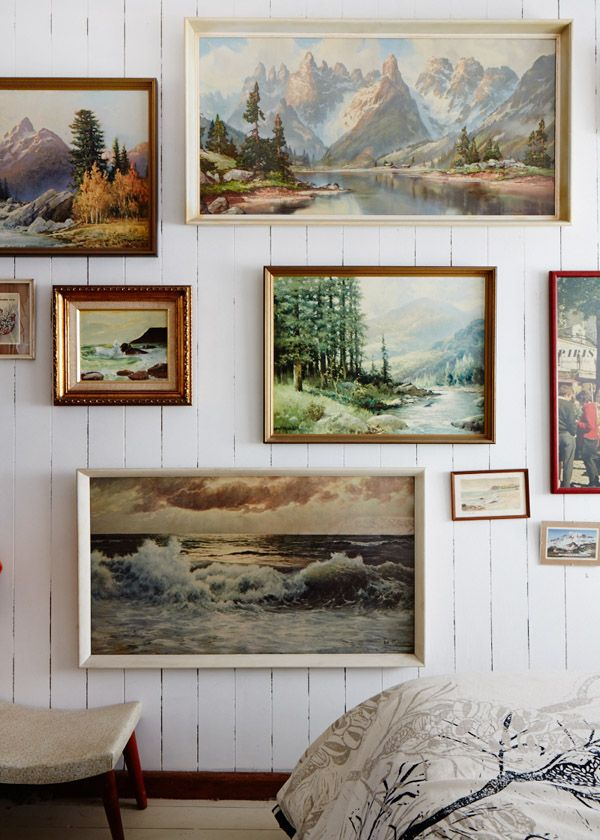 white clapboard walls, landscape paintings, gallery wall #rustic #nature #home #decor #design #livingroom #pictures