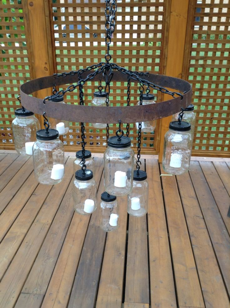 Recycle materials - whiskey barrel ring and mason jar = rustic chandelier perfect for barn venue!