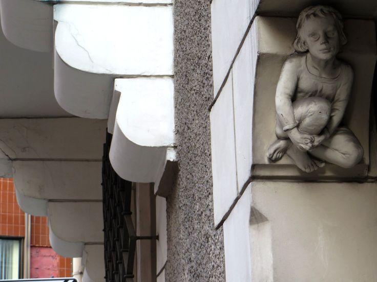 door porter - little boy - Old Town Riga/Latvia