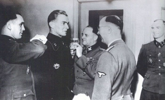 Promotion for Max Wunsche. Left to right: Kurt Meyer, Max Wunsche, Sepp Dietrich, Heinrich Himmler and Hubert Meyer (who wrote the official history of the 12th SS Hitlerjugend)