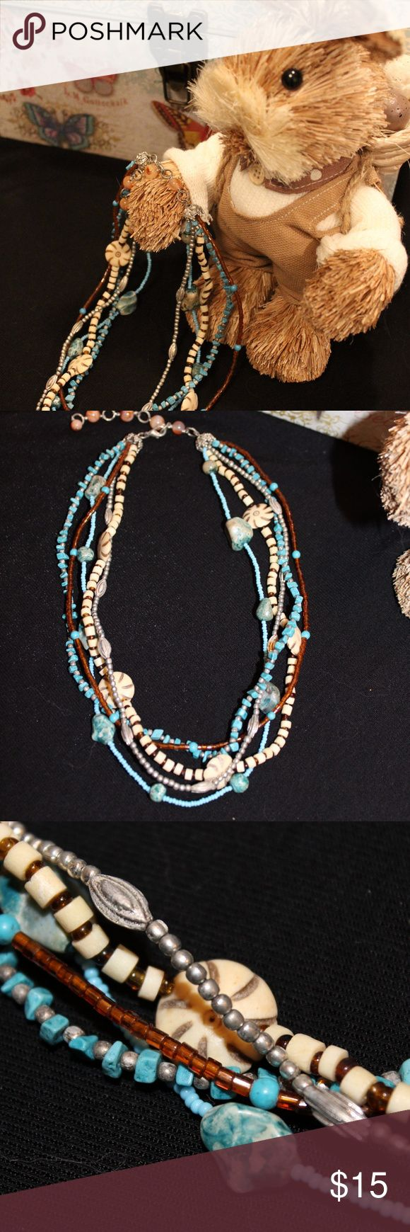 Cute Multi Strand Necklace This necklace consists of very ornate beads in aquas and browns. Jewelry Necklaces