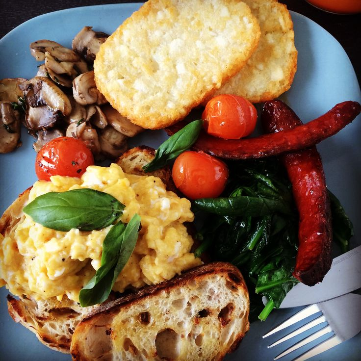 big #homemade #breakfast #brunch #truffle butter #scrambledeggs with #roasted #cherrytomatoes grilled #chorizo #mushrooms and wilted #baby spinach with a serve of #guilty pleasure store bought #hashbrowns #mornings at #home #comfortfood #colourful