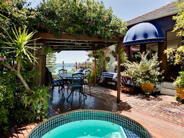 The Dolphins - The Dolphins is a spacious two-bedroom bungalow, ten steps from the popular Clifton Third Beach. Even though the bungalow is accessed by 98 steps, the secluded property is worth the journey. Clifton is ... #weekendgetaways #clifton #capetowncentral #southafrica