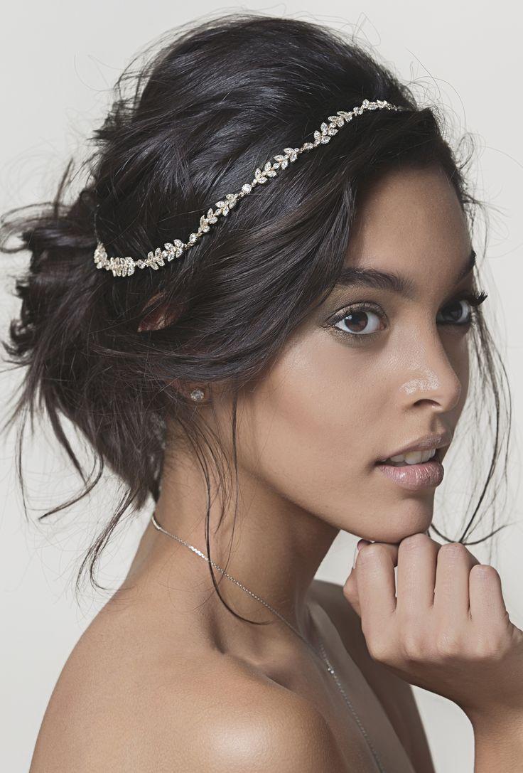 Bridal hairdo. Messy bun and an AMY O Bridal headpiece