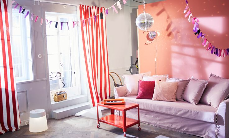 A living room decorated with bunting and disco balls.