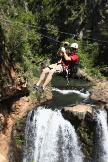 Magoebaskloof Canopy Tour - The Magoebaskloof Canopy Tour is run by Thaba-Metsi Adventures and takes people on 11 'foefie' slides between 13 platforms, all individually designed and built overlooking the Groot Letaba River with its majestic waterfalls. Fly along the slides or relax and absorb the tranquillity of your natural surroundings. Trained guides ensure the safety of each group while describing facts about the fauna, flora and ecology.