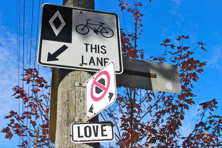 LOVE on College Street, Toronto, 2010  Photograph by Neale McDevitt. #signage #streetart #words #typography